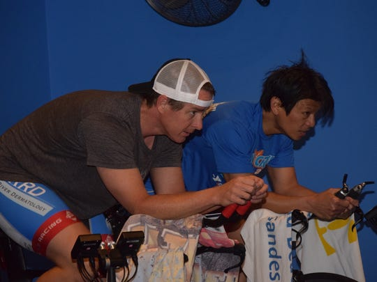 Triathletes Michael Crowell (left) and Juan Soliven