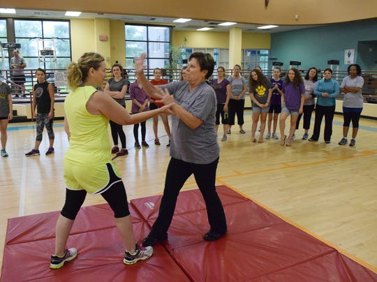 Rhonda Gremillion (left) and Denise Derbonne execute a wrist escape technique they learned at a self-defense class held Thursday. Sarah Smith, Pineville City Marshal for Wards 9, 10, and 11, said the marshal's office wanted do something for the community and approached the Louisiana Athletic Club in Pineville holding self-defense classes for women.