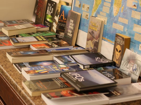 Chris Parsons shares some of his UFO book collection at the Oak Harbor Public Library.