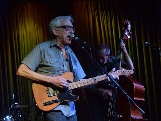 Singer, songwriter and guitarist Bill Kirchen and his band, bassist David Carroll and drummer Rick Richards, of Austin, Texas performed their brand of rockabilly music at Spirit Food & Friends Friday night.