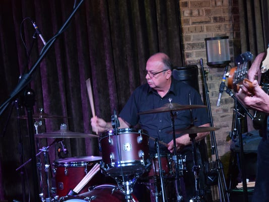Drummer Rick Richards plays drums in the band belonging to singer, songwriter and guitarist Bill Kirchen Friday night at Spirits Food & Friends.