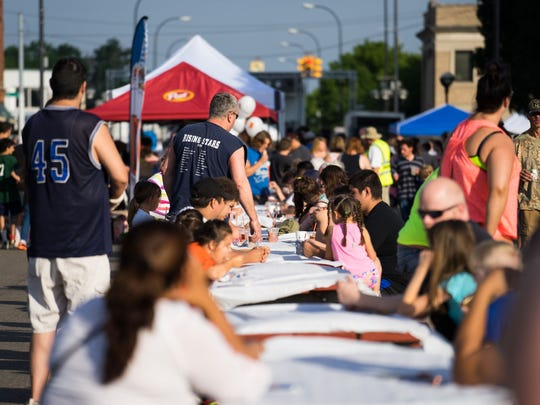 Locals enjoy the Saturday morning at the 2016 World's Longest Breakfast Table.
