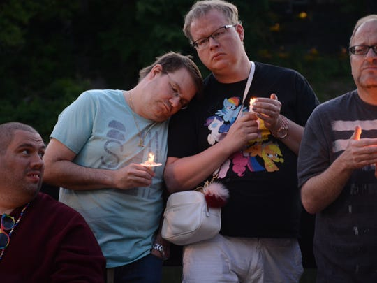 About 500 gathered in downtown Binghamton Tuesday for a vigil to remember those killed in the Orlando shooting early Sunday.
