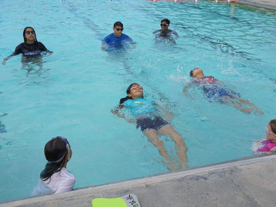 Participants swim in the Hagåtña Pool for the Summer Youth Swimming and Water Safety Program.
