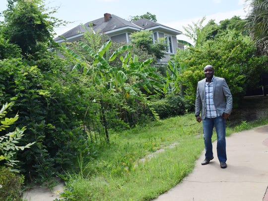 Peter Rotich is in the middle of remodeling a house at 338 Florence Ave. that he recently purchased. The house was part of Mansion Row, four stately homes built in the early 1900s on Florence. Landscaping is next on the to-do list.