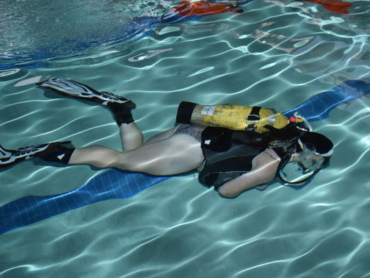"""Shae Schfeckengost graduated from Buckeye High School in May. As a graduation gift, her parents signed her up for scuba diving lessons. """"It's definitely a new experience,"""" said Schfeckengost. """"It's really fun learning new stuff."""""""