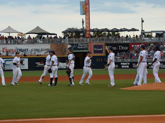 The Blue Wahoos celebrate their 3-2 win in Saturday's first game against the Mobile BayBears. They went on to win both games Saturday.