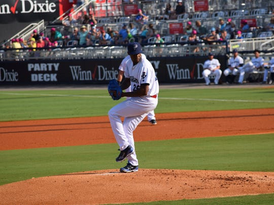 Raisel Iglesias, on his rehab assignment from the Cincinnati Reds, pitched a scoreless sixth inning in the first game Saturday, won by the Blue Wahoos.