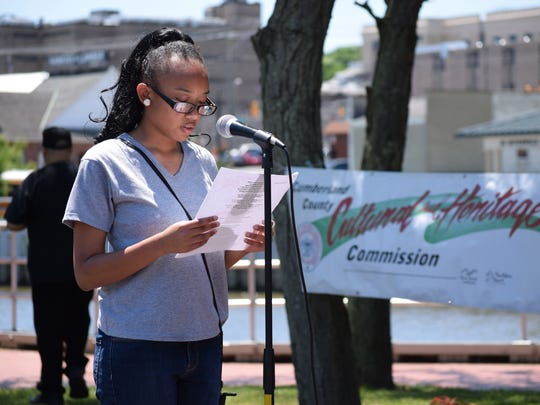 Brianna Wright, 14, of Bridgeton, reads her poem during the Juneteenth Celebration on the Cohansey Riverfront. She won first place in the Juneteenth Celebration poetry contest. Tahil Burden, 14, of Bridgeton won second place, and Yiesica Perez, 13, also of Bridgeton, won third place.
