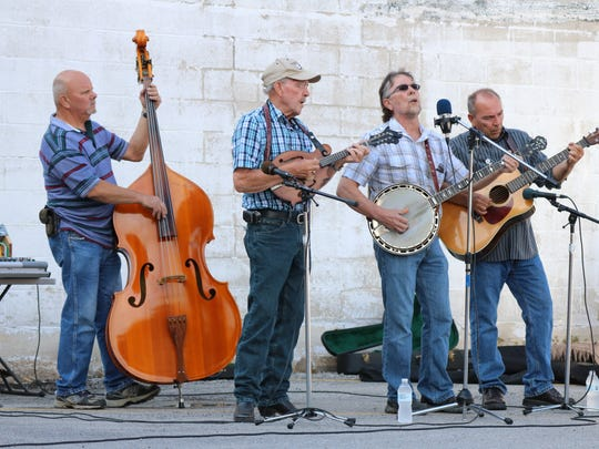 The Ottawa County Bluegrass Band performs at the  Art Walk.
