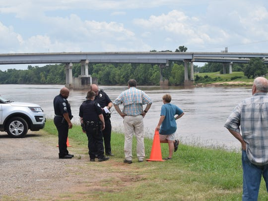 Witnesses who saw a man swimming in the Red River talk to Pineville Police officers. A man jumped off the Gillis Long Bridge, also known as the Jackson Street Bridge, Saturday afternoon. The man was last seen by witnesses on the Pineville side swimming about 50 feet from a sandbar before he went under.