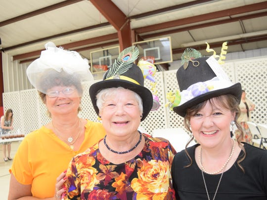 "Mary Davis (left), Jeanette Partain and her daughter Roxanne Phillips attend a mother-daughter tea Saturday at St. Frances Cabrini Church. Partain and Phillips made ""Alice in Wonderland""-themed Mad Hatter hats."