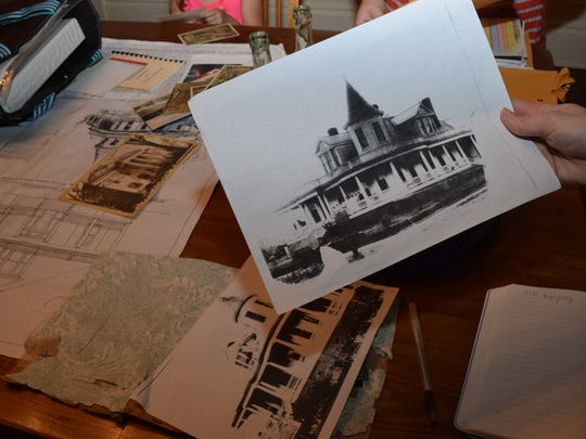 Photocopies of old photographs of the house at 96 Florence St. show what the house looked like with the turret before it was destroyed.