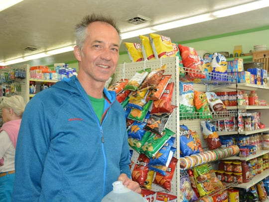 Pete Moegenburg carries groceries he bought at the