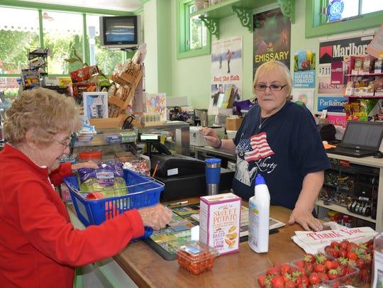 Bev Tesnow checks out customer Joan Johnson at the