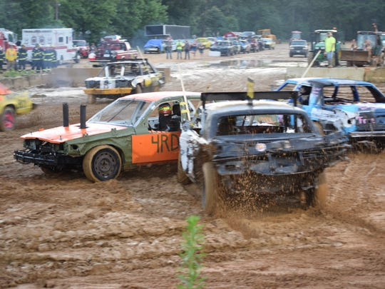 Drivers competed in muddy conditions during the Demolition