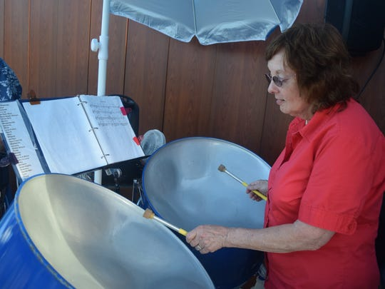 Donna Clark performs beach tunes on a bass steel drum.