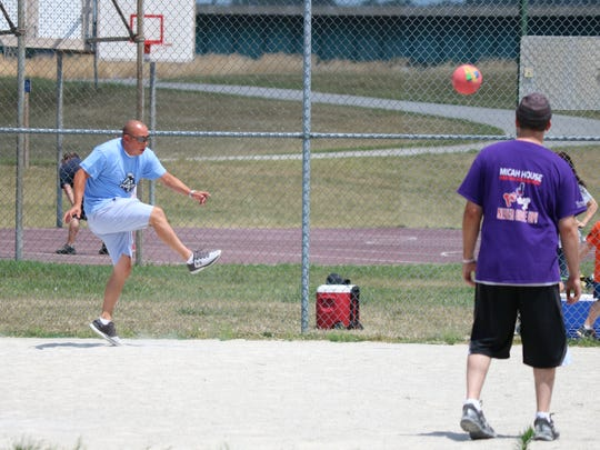 Mayor Danny Sanchez participates in a kickball tournament