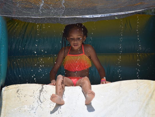 Gianna Campbell, 6, of Camden prepares to slide down
