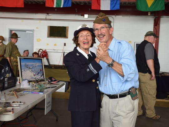 Dr. George Pantolos dances with WWII Navy veteran Edith Pitzer next to his exhibit at the 2015 KY Spirit of '45 commemorative event at Bowman Field.