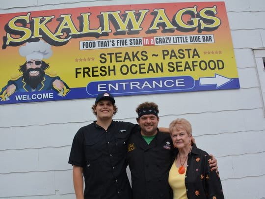 Skaliwags Chef Chris Wiltfang, center, with his son