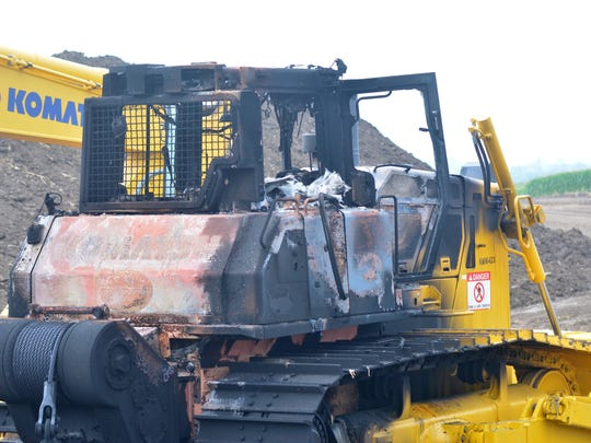Heavy equipment is seen charred Monday, Aug. 1, 2016, outside Newton, Iowa. Equipment at three construction sites along the Bakken pipeline route in Jasper and Mahaska counties was damaged after suspected arson over the weekend. Damage to bulldozers and other large tracked equipment is estimated at $1 million. Environmental groups and landowners have opposed the pipeline crossing 18 Iowa counties.