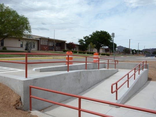 A new ramp that goes from the school's crosswalk to
