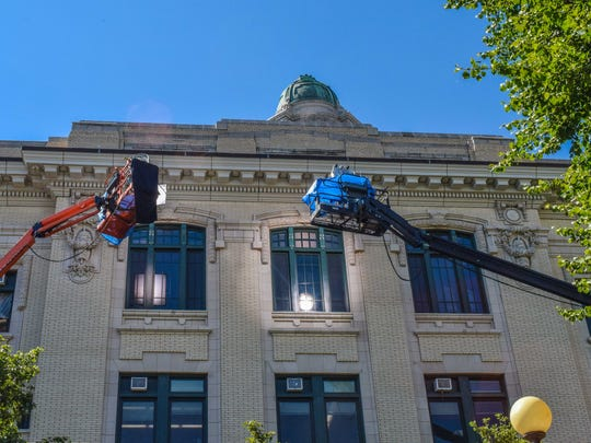 "Cranes carrying lights and cameras film from the outside of Yonkers City Hall. A new CBS show, ""Bull,"" starring Michael Weatherly, filmed scenes inside the court room."