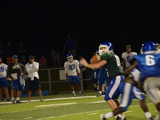 UWF quarterback Grey Jackson prepares to make a throw during Friday night's scrimmage at UWF.