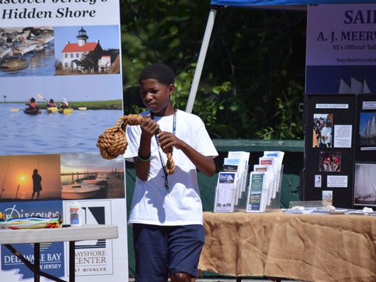 Brycen Bratley, 11, of Bridgeton checks out the items displayed by the Bayshore Center at Bivalve during Cohansey RiverFest in Bridgeton on Saturday, Aug. 27. Photo/Jodi Streahle