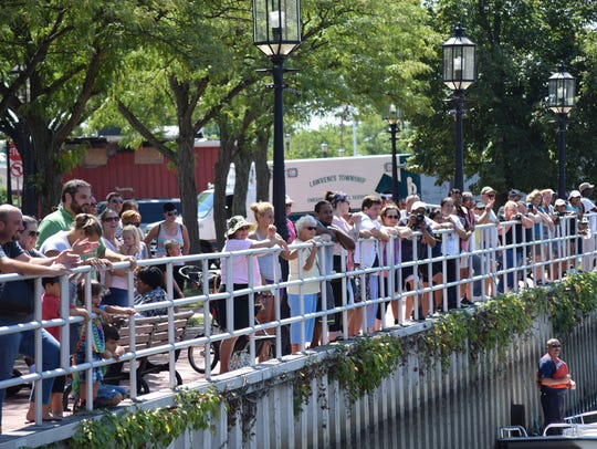Spectators lined the riverfront to watch the Community
