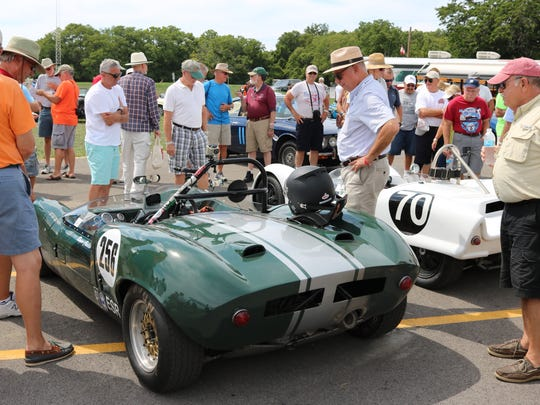 Spectators check out the vintage cars at the winner's circle, a new feature to the Put-in-Bay Road Races Reunion.