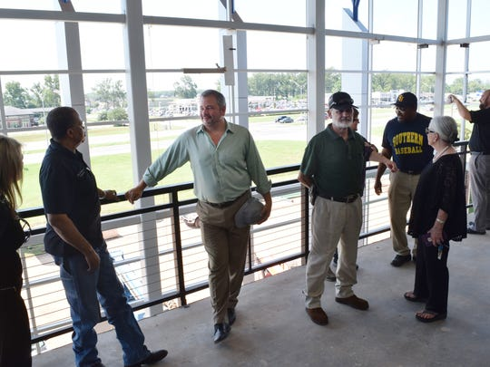 Bill Tudor (center) of Alliance Design Group chats with Police Juror Ollie Overton during a tour of the Rapides Parish Coliseum, which is being renovated.