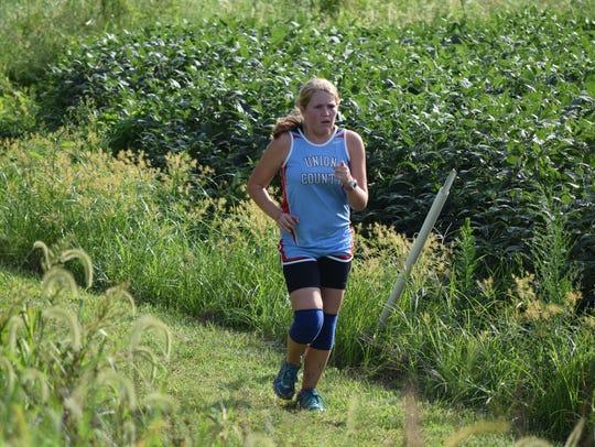 Bravette Payton Wilson runs around the field in the