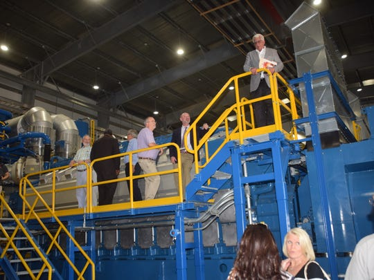 Visitors look over the new high-efficiency generators at D.G. Hunter power plant in Alexandria following a dedication ceremony in May 2016.