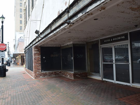 The city of Alexandria is considering acceptance of the proposed donation of the vacant Weiss & Goldring building on Third Street.
