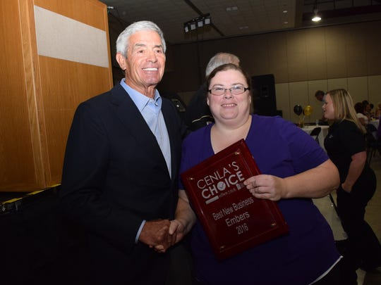 """Jennifer Atwood (right), owner of Embers, poses with former Saints coach Jim Mora after being honored with """"Best New Business"""" in the Cenla Choice Awards."""