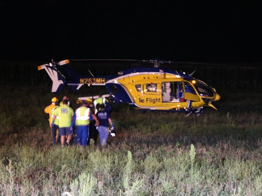 A female pickup truck driver was flown by medical helicopter