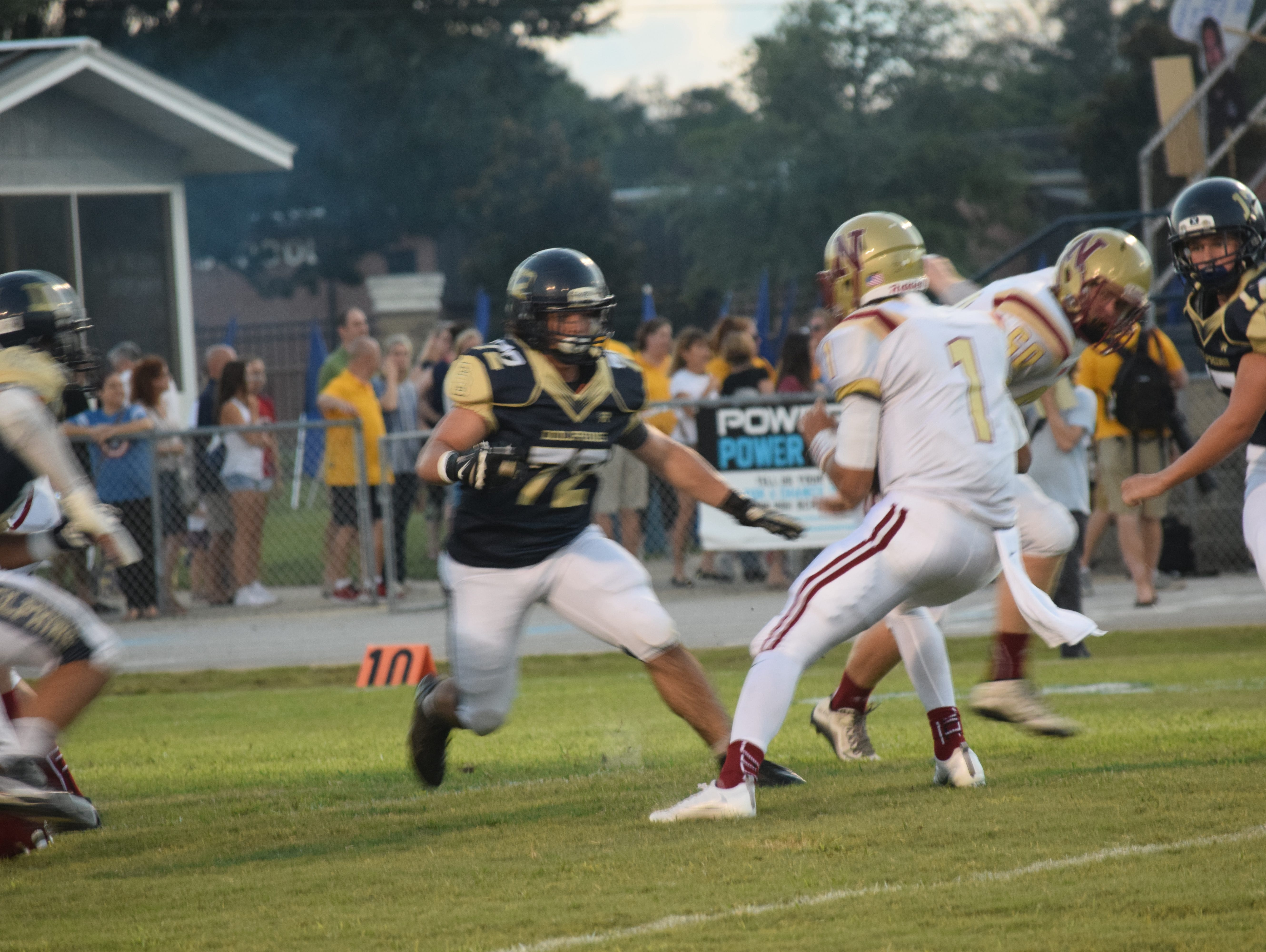 Gulf Breeze defensive lineman Liam Gesler closes in on Northview quarterback Luke Ward in Friday night's 42-0 win at Dolphin Stadium.