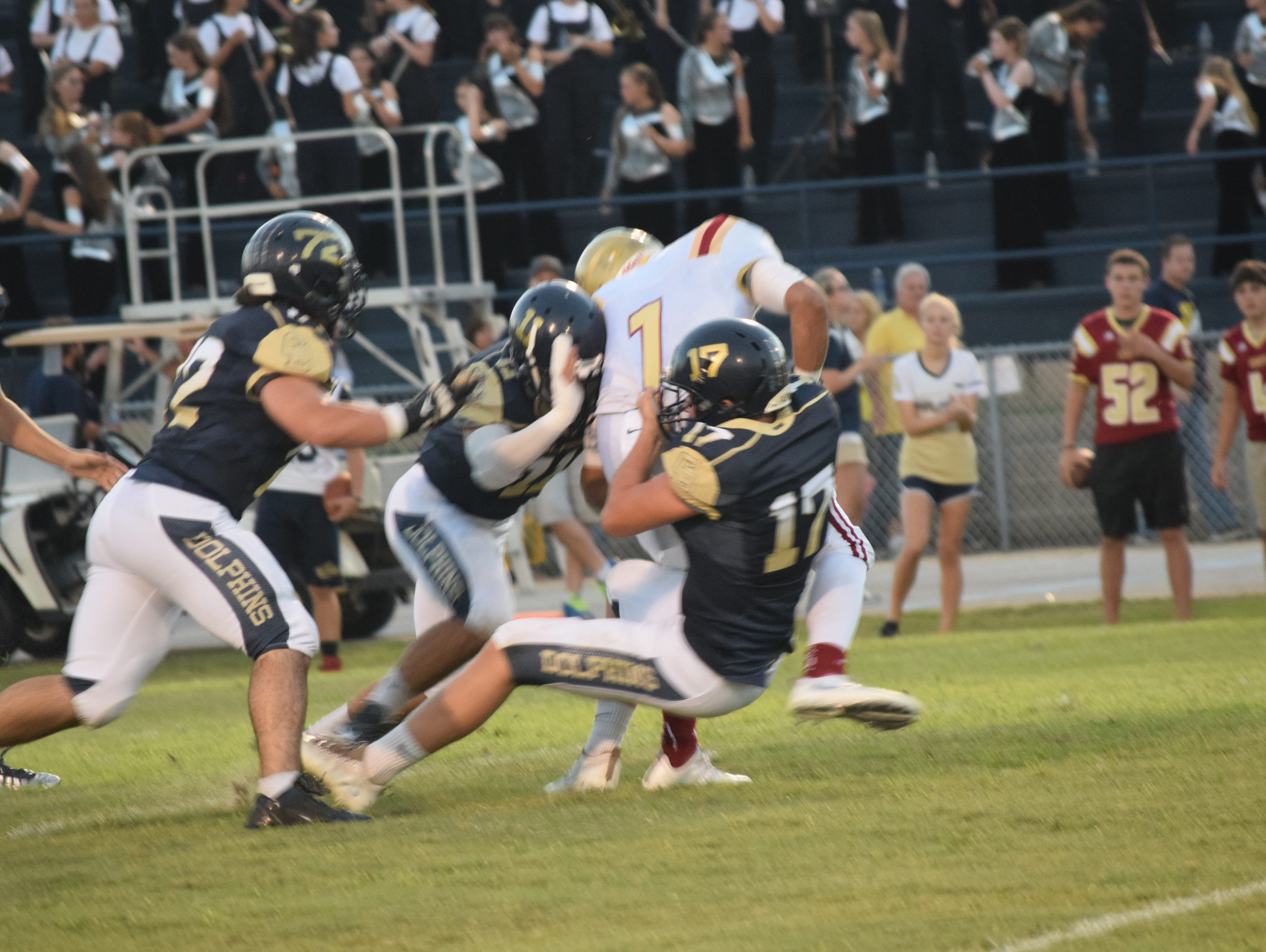 Gulf Breeze linebacker Will Sawarynski brings down Northview quarterback Luke Ward as Ben Dobry (11) and Liam Gesler (72) close in during first quarter of Friday night's game at Gulf Breeze.