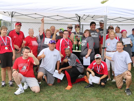 Members of the Sandusky County Rebels are recognized at the Mike Piero Memorial softball tournament on Saturday.