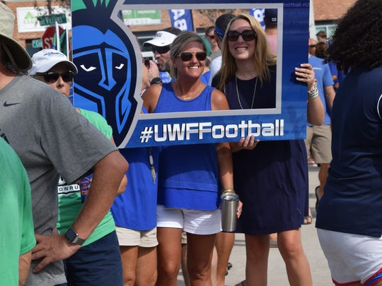UWF supporters enjoy the moment Saturday in tailgating party before Argos first home football game at Blue Wahoos Stadium.