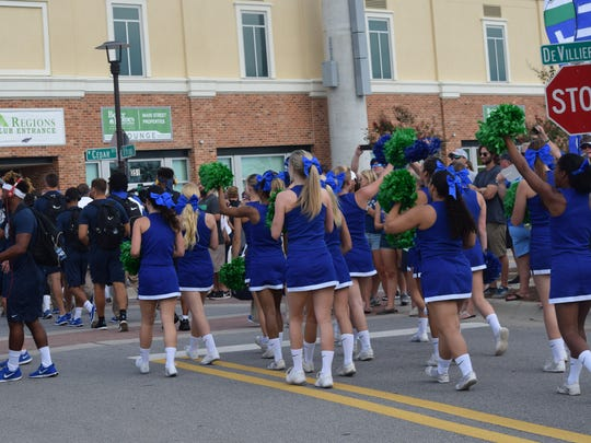 UWF cheerleaders cheer the players all the way into locker room entrance during Argo Walk Saturday before team's first home football game at Blue Wahoos Stadium.