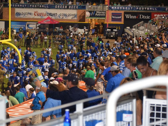 UWF players greet fans in a mass of people following the Argos' 45-28 win Sept. 10 against Missouri S&T in the first home football game at Blue Wahoos stadium.