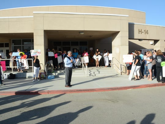 Teachers, parents and students in Coachella Valley Unified School District rallied outside of Desert Mirage High School where a board meeting was held on Tuesday, September 13, 2016. The community gathered to protest stalled contract negotiations that have been ongoing for more than a year.