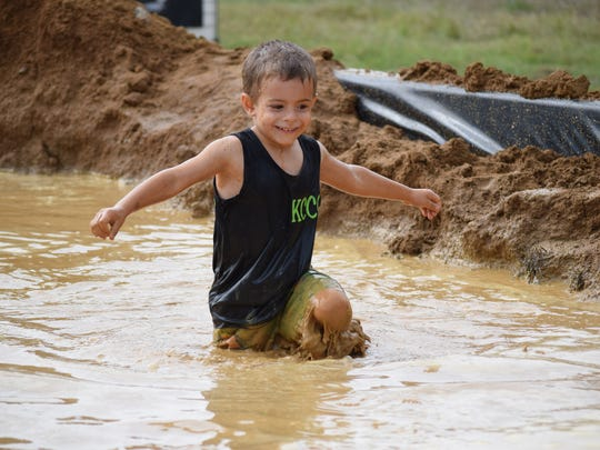 Thomas Napolitano, 4, of Sicklerville approaches the finish line during the kid's mud run at the Bill Bottino Mud Run for Cancer on Saturday, Sept. 17. Photo/Jodi Streahle