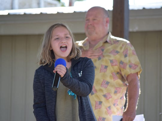 Isabella Bottino, 11, of Newfield sings the National Anthem at the 2016 Bill Bottino Mud Run for Cancer on Saturday, Sept. 17. Photo/Jodi Streahle