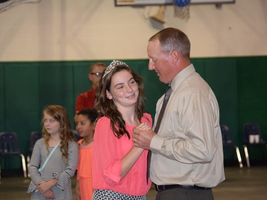 Rylee, 12, and her father Casey Thomas share a dance after Rylee is named queen at Old National Bank's eighth annual Daddy-Daughter Dance and First Mother-Son Dance.