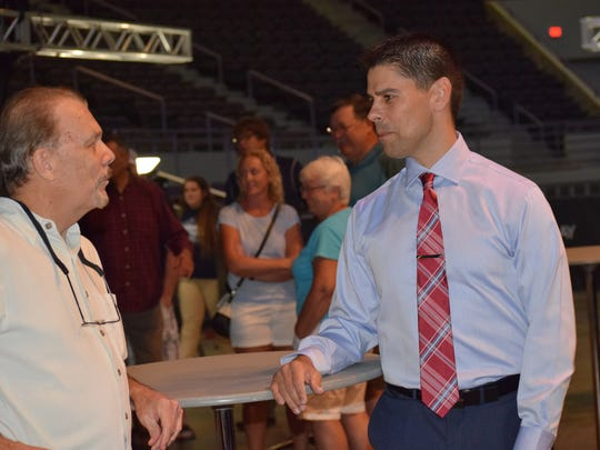 New Ice Flyers coach Kevin Hasselberg greets fans at a reception Sept. 20 at the Bay Center.