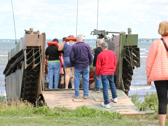 Visitors of the Port Clinton Homecoming Festival board a 1945 LVT-4 Water Buffalo, a historic amphibious military vehicle, which was offering rides to the public.